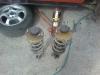 Abu galiniai mazda amortizatoriai - atraminės plokštelės pažeistos korozijos