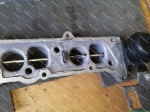 Išplautas Opel dyzelinio variklio kolektorius ir jo dalys;