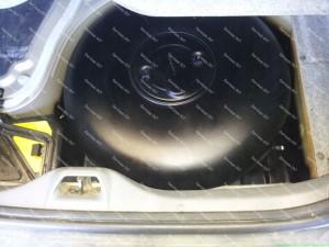 Toroidinis dujų balionas automobilio bagažinėje